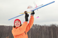 Woman played with airplane at winter Stock Photos