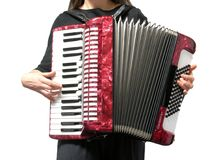 Woman playing accordion on white Stock Images