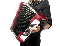Woman playing accordion on white. Cutout with a woman playing accordion on white royalty free stock images