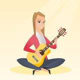 Woman playing the acoustic guitar. Royalty Free Stock Photos