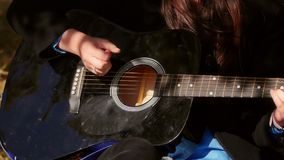 Woman playing acoustic guitar stock footage