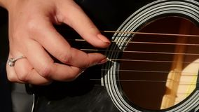 Woman playing acoustic guitar stock video footage