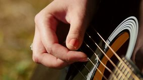 Woman playing acoustic guitar stock video