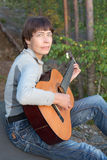Woman playing an acoustic guitar Royalty Free Stock Photo