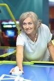 Woman playing air hockey Royalty Free Stock Photos