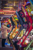 Woman playing in amusement arcade Royalty Free Stock Photos