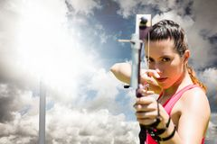 Woman playing archery with cloudy weather Royalty Free Stock Photography
