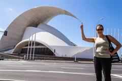 Woman playing with the Auditorium. Auditorium of Santa Cruz de Tenerife in Spain Stock Photo