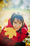 Woman Playing With Autumn Leaf Stock Photography