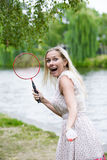 Woman playing badminton Royalty Free Stock Images