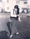 Woman playing badminton outdoors Royalty Free Stock Image