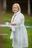 Woman Playing Badminton In Park Stock Photography