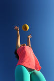 Woman playing with a ball Royalty Free Stock Photo