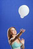 Woman playing with balloon Royalty Free Stock Photo