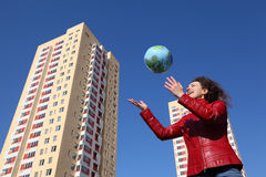 Woman playing with balloon in form of globe Royalty Free Stock Photos