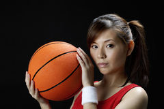 Woman playing basketball Royalty Free Stock Images
