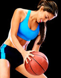Woman playing basketball Stock Photography