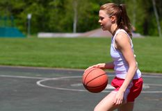 Woman playing basketball Royalty Free Stock Photo