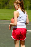 Woman playing basketball Royalty Free Stock Photography