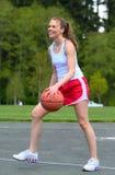 Woman playing basketball Stock Photo