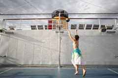 Woman playing basketball on deck of cruise ship Royalty Free Stock Photography
