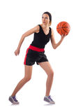The woman playing basketball isolated on white Stock Photography