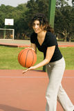 Woman Playing Basketball - Vertically framed ph Stock Photo