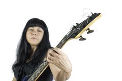 Woman playing a bass guitar Stock Photo