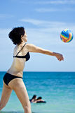 Woman playing beach volleyball Royalty Free Stock Photo