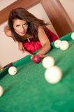 Woman playing billiards Royalty Free Stock Photo