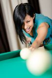 Woman playing billiards. Spending free time on gambling stock photos