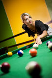 Woman playing billiards royalty free stock images