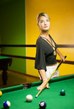 Woman playing billiards Stock Photos