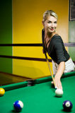 Woman playing billiards Royalty Free Stock Photos