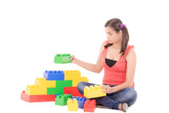 Woman playing with blocks Stock Image