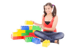 Woman playing with blocks Stock Photos