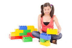 Woman playing with blocks Stock Photography