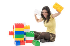Woman playing with blocks Stock Images