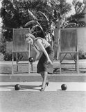 Woman Playing Bocce Outdoors Royalty Free Stock Photo