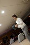 Woman playing bowling Stock Photos