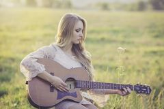 Woman Playing Brown Wooden Acoustic Guitar during Daytime Stock Image