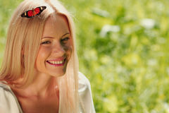 Woman playing with a butterfly Royalty Free Stock Images