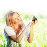 Woman playing with butterfly Royalty Free Stock Photo