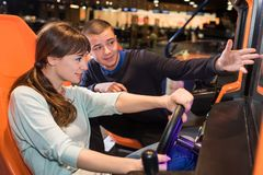 Woman playing car driving game Royalty Free Stock Photography