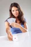 Woman playing cards with ace of hearts in her hand Stock Photography