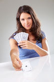 Woman playing cards with ace of spades in her hand Royalty Free Stock Photos