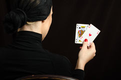Woman with playing cards (black jack pair) Royalty Free Stock Images