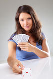 Woman with playing cards, focus on ace of hearts Royalty Free Stock Photos