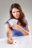 Woman with playing cards, focus on ace of spades Stock Photos