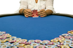 Woman playing cards with poker chips Stock Photography